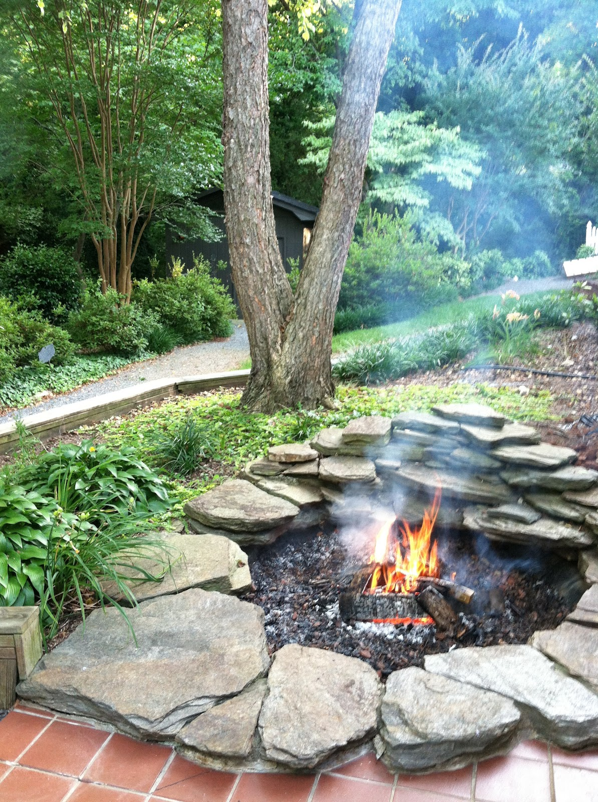 12 diy fire pits for your backyard the craftiest couple for Backyard rock fire pit ideas